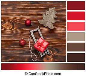 Christmas Decorations. Gift Box On Sleigh. Wooden Background. Palette With Complimentary Colour Swatches