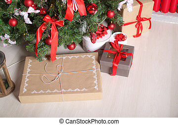 Christmas decorations gift boxes in wrapping paper near Christmas tree