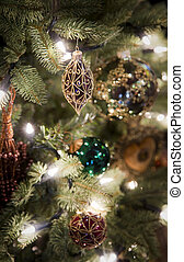 Christmas decorations hanging on a tree.