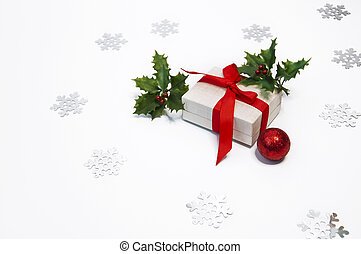 Christmas decorations holly and gift boxes on white background