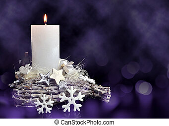 Christmas decorations in the shape star and snowflake with burning candle.