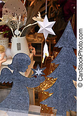 Christmas decorations in the shop window. New Year and Christmas decorations