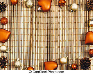 Christmas decorations laid out on a bamboo background with copy space for text. Beautiful background for new year greeting card