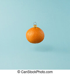 Christmas decorations made from orange tangerine fruit. Minimal New Years concept.