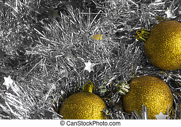 Christmas decorations on a background of shiny tinsel