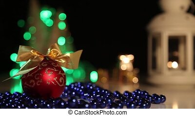 Christmas decorations on a background of flashing lights.