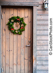 christmas decorations on a wooden door