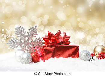 Glittery gold Christmas background with decorations in snow