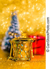 Christmas decorations on sparkling golden background
