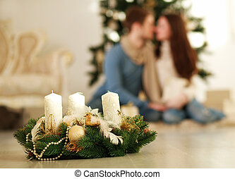 Christmas decorations on the background of couple in love