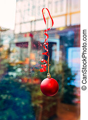 Christmas decorations on the window. New Year and Christmas decorations