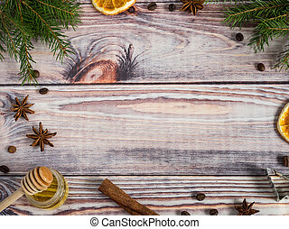 Christmas decorations on wooden background, orange, cinnamon, stars, fir branches. Copy space.