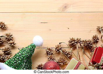christmas decorations on wooden board background