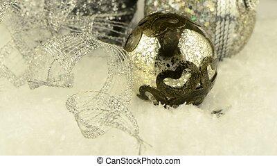 Christmas decorations rotating on dark background.