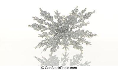 Christmas decorations rotating on white background.
