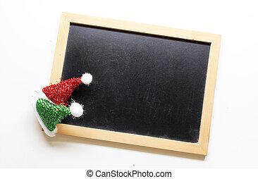 christmas decorations santa hat on wooden blackboard background