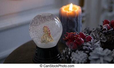 Christmas decorations. Shiny magical crystal ball. Snow...