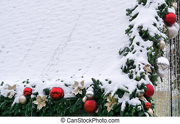 Christmas decorations under snow