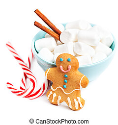 Christmas decorations - White Fluffy marshmallows with gingerbread man cookie isolated on white background.