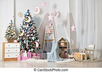 Christmas decorations with a Christmas tree in a bright children's bedroom