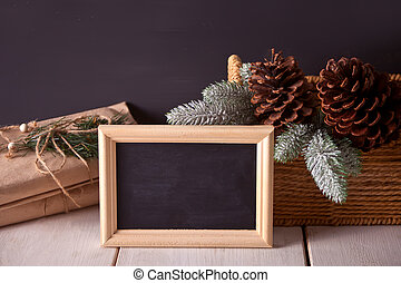 Christmas decorations with blackboard on the black background