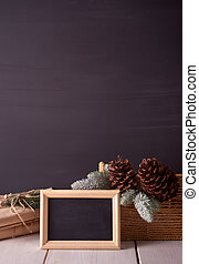 Christmas decorations with blackboard on the black background with copy space