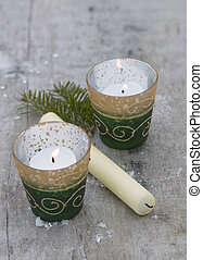 christmas decorations with candels on wooden background