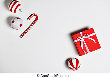 Christmas decorations with candy cane, gift box and christmas toys on white background.
