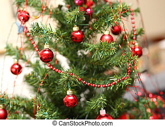 Christmas decorations with red glass balls decorate a large Christmas tree