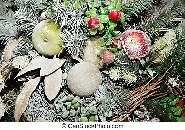 Christmas decorations with squirrels covered with frost, balls and cones.