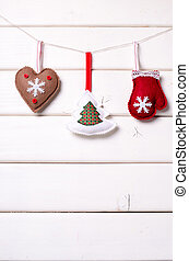 Christmas decorations with stars and tree on white wooden background. Xmas and Happy New Year composition. Vertical.