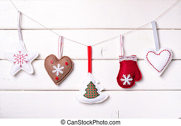 Christmas decorations with stars and tree on white wooden background. Xmas and Happy New Year composition. Horizontal.