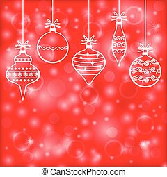 Christmas decorative baubles on red blur background
