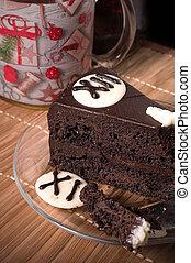 christmas decorative cake with christmas cup of tea.