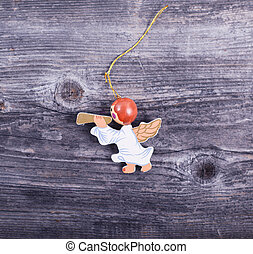 Christmas decorative ornament - Angel with flute on wooden background