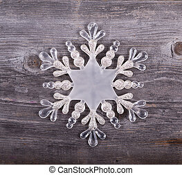 Christmas decorative ornament - Snowflake on wooden background