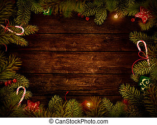 Christmas design - Merry Christmas. Xmas border card with with copyspace on wooden background. Christmas ornaments on wood with candy and ribbons.