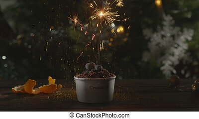 Christmas dessert with confetti and sparkler