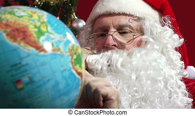Christmas Destination - Close-up of Santa choosing the...