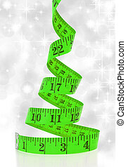 Christmas diet concept. Christmas tree made from measure tape