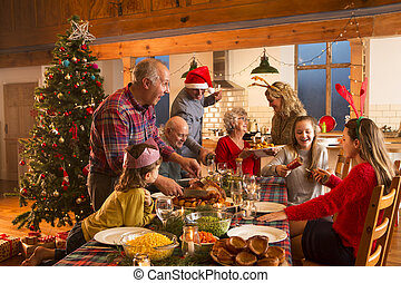 Christmas Dinner - A large family are all helping serve...