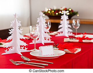 Christmas dinner table setting with name card in red