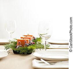 Christmas Dinner table setting in beige orange color