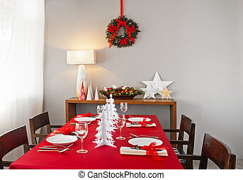 Christmas dinner table setup with decoration on the side...