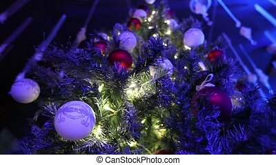 Christmas disco at the restaurant, a Christmas tree on the background of a disco, dancing silhouettes of people, light rays,, Christmas tree with toys, a banquet