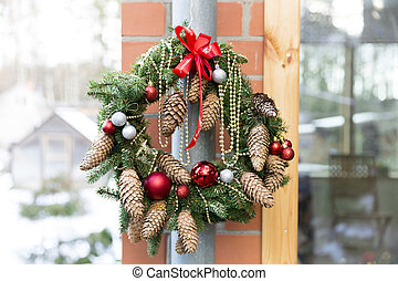 Christmas door wreath with pines and Christmas decorations