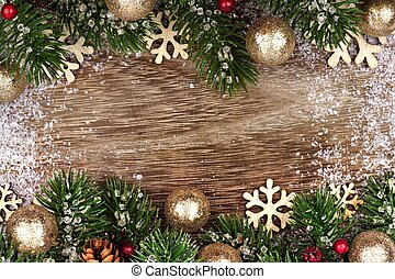 Christmas double border with gold ornaments, branches on...