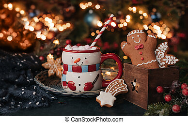 Christmas drink and cookies with festive decor