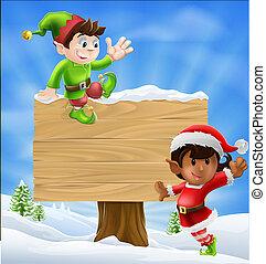 Christmas Elves and Sign - Seasonal cartoon of two Christmas...