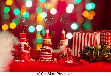 christmas elves, santa and snowman toy with lights background